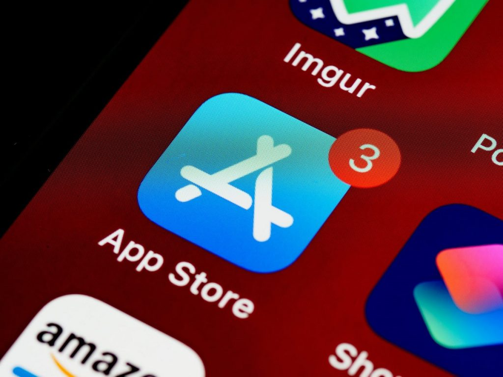 Using app store, you must pay part of your revenue in commission to Apple.